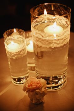 Simple centerpieces for some of the tables? Glass Vases Wrapped in Lace