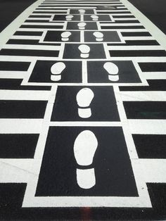 """Hopscotch Crosswalk in Baltimore, MD, designed by Graham Coreil-Allen - photo from DesignTAXI; """"Each of the [four] hopscotch-court-crosswalks feature one of Baltimore's signature path-print—the Shoe, the Bird Track, the Boot and the Footprint."""""""