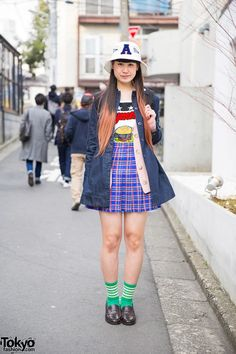 May 2015: Gyorome's jacket and t-shirt are from Seto Ayumi's brand Aymmy in the Batty Girls while her plaid skirt is from Bubbles Harajuku. She is also wearing Monsters Inc earrings, green socks, loafers and an American flag backpack is from the Japanese brand RNA.
