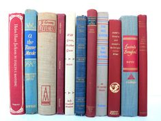 Need to fill that empty bookshelf? Beautiful earth tone books with a hint of shabby chic. Red Blue Tan Vintage Books / Book Decor / Earth Tones / Decorative Books / Instant Library / Library Filler / Home Decorating by Redladybugz on #etsy #vintage
