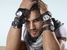 guy wearing many watches