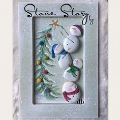 Very cute framed stone snowman with Christmas tree painting.