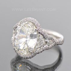 Halo style oval engagement ring with double side stones.  Unique look!