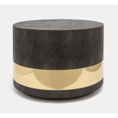 Glam and texture are the hallmarks of this '70's inspired coffee table. Covered with luxurious faux shagreen and shiny brass, the pieces of this ultra-cool collection of accents don't take themselves
