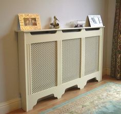 Not sure if there is space to fit a radiator cover but a slim line one would improve the look of the hall so much.