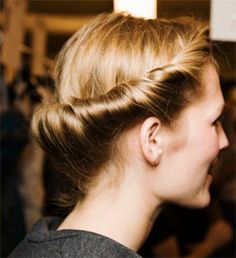 Retro Roll | roll hair from the bottom up, tucking in from the top section and pinning as necessary