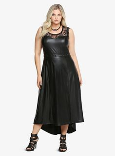 This is a real no non-nonsense black dress. It's lightweight faux leather with a sweetheart neckline and lace inset. A belted waist gives a figure-flattering fit while a hi-lo hem finishes this sexy look off in a trendy way.%0A