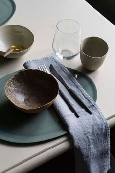 Handcrafted deep in the Norwegian forests as an exclusive product for the underwater restaurant, Under, these contemporary ceramic bowls from Ment are a treasure for any unique dinnerware set. The round bowls are glazed inside and matte outside, using the sand from the surrounding nature to create a one of a kind colour and texture. Shop the distinctive Scandinavian style at The Culture of Art to create your minimalist kitchen. #luxurytablesetting #scandinaviandesign #tablescape #tableware