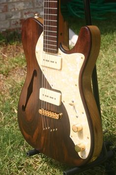 Rosewood Tele with low–coat Tung Oil finish.