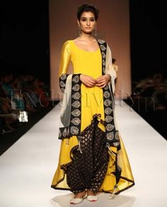 #Exclusivelyin, #IndianEthnicWear, #IndianWear, #Fashion, Noor Sunset Yellow High Low Suit With Black Patiala Salwar