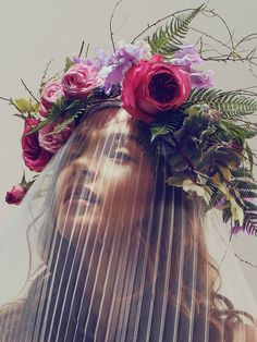 Sunburst-pleated full- cascade veil by Reem Acra; hand-wired headdress of garden roses, hellebores, sweet pea, ferns, and spirea by the Designers' Co-Op. Natural Beauties: Summer's Effortlessly Gorgeous Wedding Gowns - The Cut