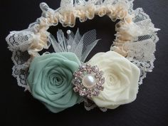Sage Ivory Rose Lace Garter Something Blue Bride Bridal Silk Rosebud Wedding Flower Rhinestone Jewel Pearl Cream Green Woodland Mint Royal. $45.00, via Etsy.