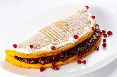 Try this simple, buy very harmonic dish that is traditional to the region of Koroška, called Pohorska Omelette. But beware - the perfect balance of the sweet dough and the savoury cranberries can be addicting! Sweet Dough, Omelette, Cheesecake, Dishes, Breakfast, Ethnic Recipes, Desserts, Food, Cranberries