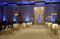 Inverted centerpiece design with soft touches of candles. #flowers #wedding #candles