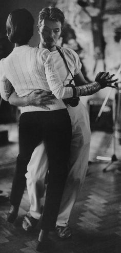 husband David Bowie (the musician, 1947-2016) & wife Iman (the model & entrepreneur, b.1955) dancing. Photographer unknown.