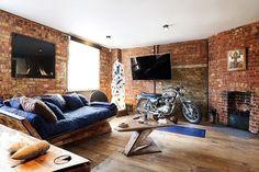 typisch Loft Raumgestaltung mit Backstein Wänden