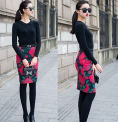 Floral skirt with black top, belt, tights and booties. I would wear a longer skirt.