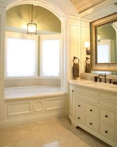 tub alcove   Serene alcove tub surrounded by windows and with a bright pendant lamp