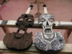 I like the one on the right, It's kind of like a dia de los muertos design...