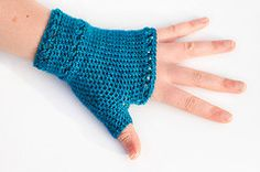 Crochet fingerless gloves pattern.  There are some things that I just don't care how it looks when crocheted and fingerless gloves are one of them BUT this pattern actually has a similar look to some knit stiches.