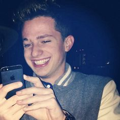 Charlie Puth looking at his phone