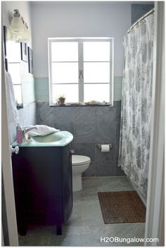 My creative small bathroom remodel made the most of the space and features in our 1950's waterside bungalow with a modern feel, stone and frosted glass
