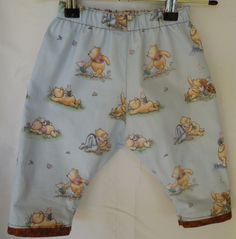Poofy Pants.  Extra roomy to fit over a cloth or modern cloth nappy/diaper.  Reversible, with a different Winnie the Pooh fabric on each side.  Leg cuffs to roll up, and roll back down for more length.