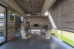 Image 16 of 24 from gallery of Berazategui House / Besonías Almeida Arquitectos. Photograph by Federico Kulekdjian Contemporary Architecture, Architecture Design, Concrete Houses, Commercial Architecture, House Made, Upholstered Chairs, Beautiful Interiors, Detached House, Interior Inspiration