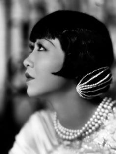 Anna May Wong. really interesting snood showing how long hair could have that bob look.  If anyone has attribution for the image, or the date, please let me know-- I tried tineye, but had no luck.