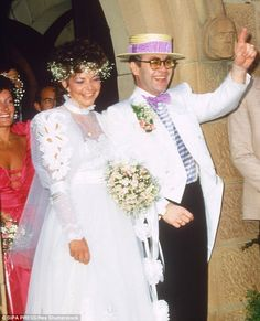 Happy time: Elton and Renate married on Valentine's Day 1984, and the singer looked overjoyed on their wedding day. The couple divorced four years later, in 1988