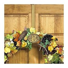 Monogrammed Wreath Hanger - Improvements by Improvements. $29.99. Monogrammed Wreath Hanger is easy to use and move, plus makes a great gift!. This over-door wreath hanger is ideal for Christmas wreaths and other seasonal wreaths. Wreath hanger uses your initial to add a note of distinction to your front door. Wreath hanger uses your initial to add a note of distinction to your front door. This over-door wreath hanger is ideal for Christmas wreaths and other seasonal w...