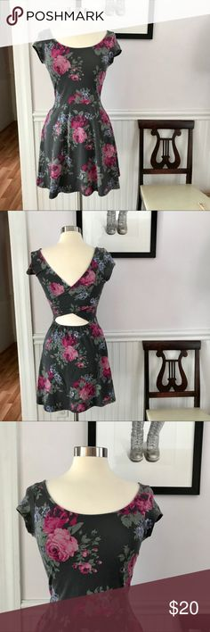 "NWOT American Eagle gray floral skater dress New Without Tags.  Size sticker is still attached to the front.  Cotton blend.  Dark gray with dark pink floral pattern.  Criss-cross design in back.  Skater style.  Scooped neck.  Capped Sleeve.  Approximate measurements taken with garment laying flat: underarm to underarm 15"", waist 12.5"", hips 24"", shoulder seam to waist 15"", shoulder seam to hem 33"" American Eagle Outfitters Dresses Mini"