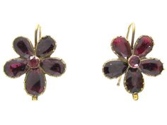 "A pretty pair of gold, flat cut garnet earrings in the form of pansies – literally meaning ""pense à moi"" (think of me), which is a pun on the word ""Pansy"". The Georgians loved hidden meanings and innuendo in their jewellery. 1,500"