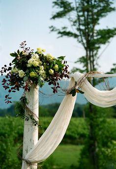 Shabby-chic arbor, white fabric drapery, cream florals // Jen Fariello Photography