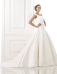 Pronovias Balder style 9/27 Costura 2015. Love the wrap-around neckline - Show my collarbone but not low in front or back. Very modern dress. Not the lace I was thinking, but I'd love to try this on.