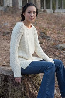 Gansey-inspired stitch patterns traverse this knitted sweater from designer Jesie Ostermiller. Knit in the round from the bottom up, this sweater features asymmetrical bottom hems and raglan sleeve shaping.