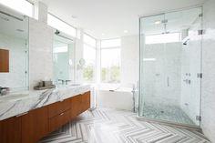 Herringbone tile pattern in the bathroom. via Laurauinteriordesign.com