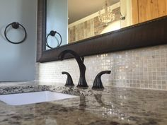 Master bath with granite counter tops and custom framed mirror