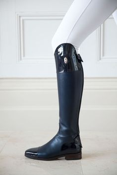 Equestrian competition style. White breeches and shiny black boots