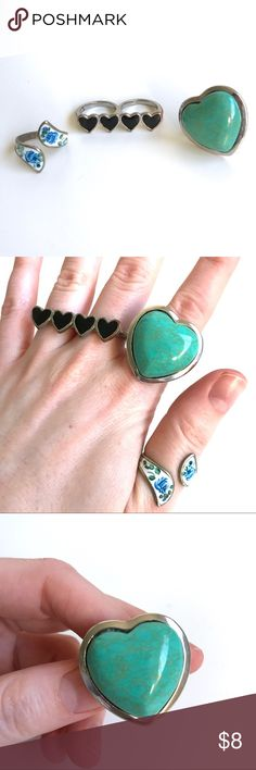 Three Ring Bundle! -Three ring bundle! Contains one large turquoise heart ring with adjustable band, one white adjustable ring with blue roses, and one two-finger ring with four black hearts. -Good condition, some natural tarnish has occurred, and some of the paint is chipping on the sides of the white ring (see photos)  -Please ask me if you have any questions! -Open to offers or bundle and I will send you an offer! Jewelry Rings