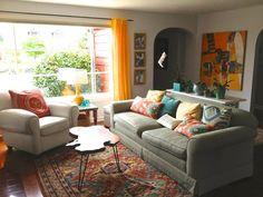 Cheerful color living room.  Although a little matchy, I love the teal & gold, painted bookshelf and oriental rug.
