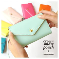 Handmade crown smartphone pouch wallet K with strap by Donbook. The Handmade Crown Smartphone Pouch is a very useful and well made smartphone pouch. The All in one pouch wallet features a wallet and cellphone(smartphone) pouch at one time.
