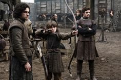 """Bran Stark gets an archery lesson in the """"Game of Thrones"""" premiere. Description from hitfix.com. I searched for this on bing.com/images"""