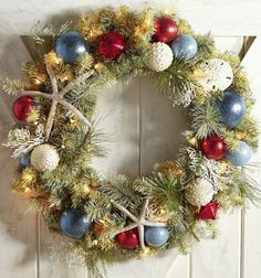 The Perfect Coastal Christmas Wreath...on Sale: http://www.completely-coastal.com/p/coastal-sale-island.html It's large, pre-lit, and made with faux sea life (not harvested from the ocean).