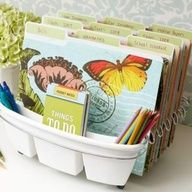 Favorite office organization idea of the day: dish strainer as file and pencil organizer.