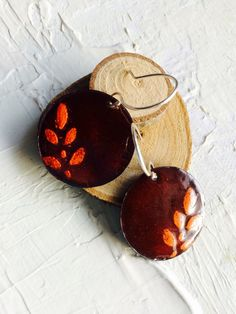 A personal favorite from my Etsy shop https://www.etsy.com/listing/249996656/red-earrings-with-orange-leaf-motif