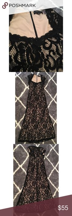 Worn once- like new black and nude gown Worn once like new  Betsy & Adam black and nude gown Betsy & Adam Dresses