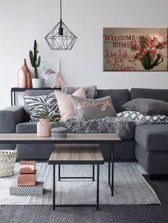 Contemporary living room with grays, wooden accents and metal