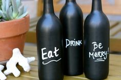 blackboard painted wine bottles, I have about twenty of these that I got for free on Craigslist as table numbers