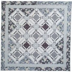 Large blocks with a touch of piecing are the perfect place to feature your favorite large-scale prints. This simple, yet elegant quilt is sure to become a treasured heirloom.
